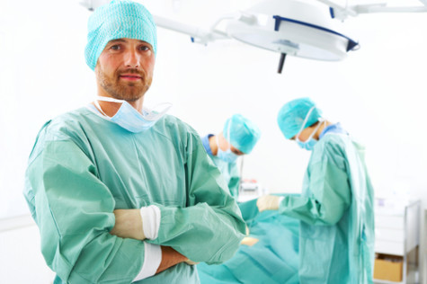 Surgeon posing for a picture after a successful operation (Photo Credit via actifit.info)