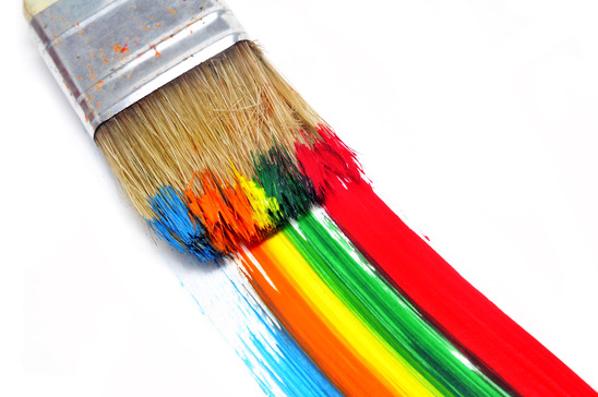 a brush with paint and brushstrokes of different colors in a white background