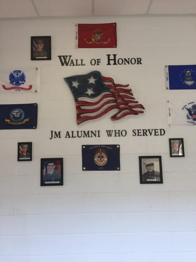 The Wall of Honor surrounded by America's armed forces and their flags. (Photo Credits via Michael Pochron)