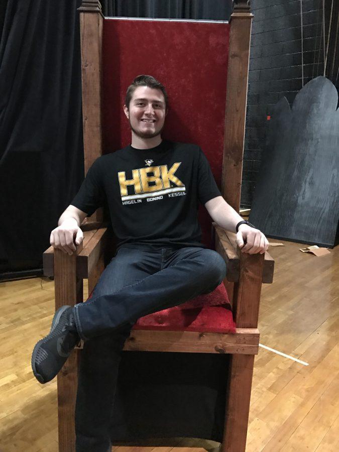 Cast member Nicholas Headley sits in the