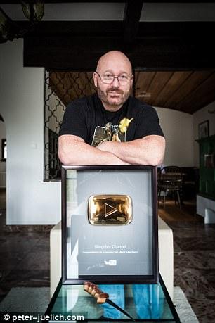 Jörg Sprave resting on his  1 million subscriber plaque.