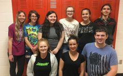 Members from NHS and Leo Club pack lunches for students.