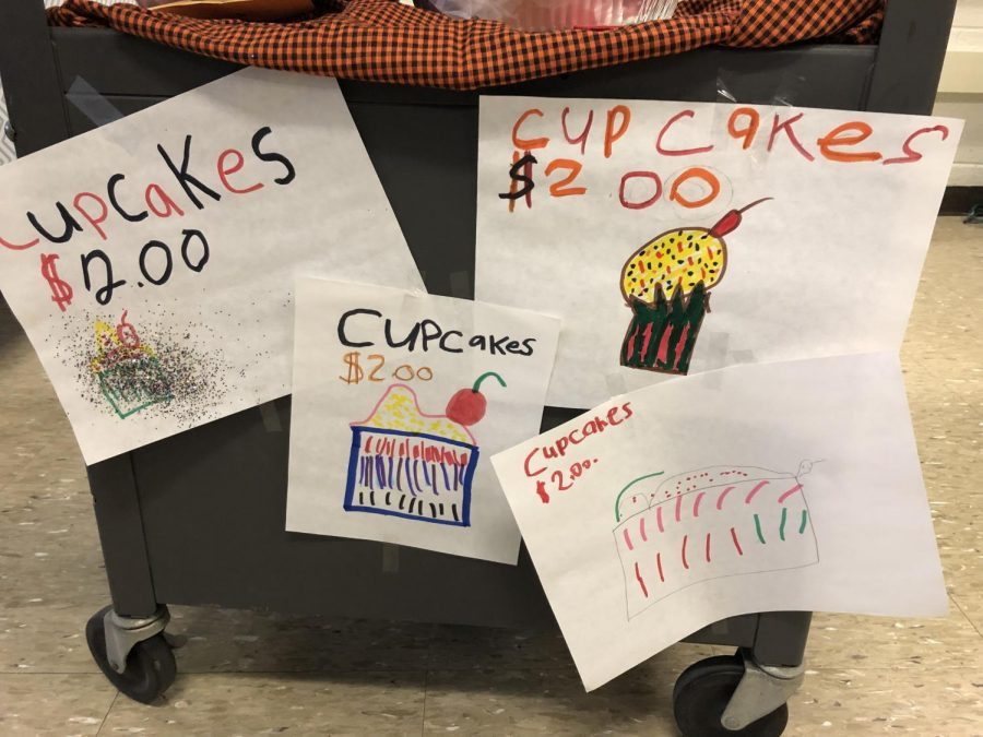 Students+created+advertisements+for+their+cupcakes.+