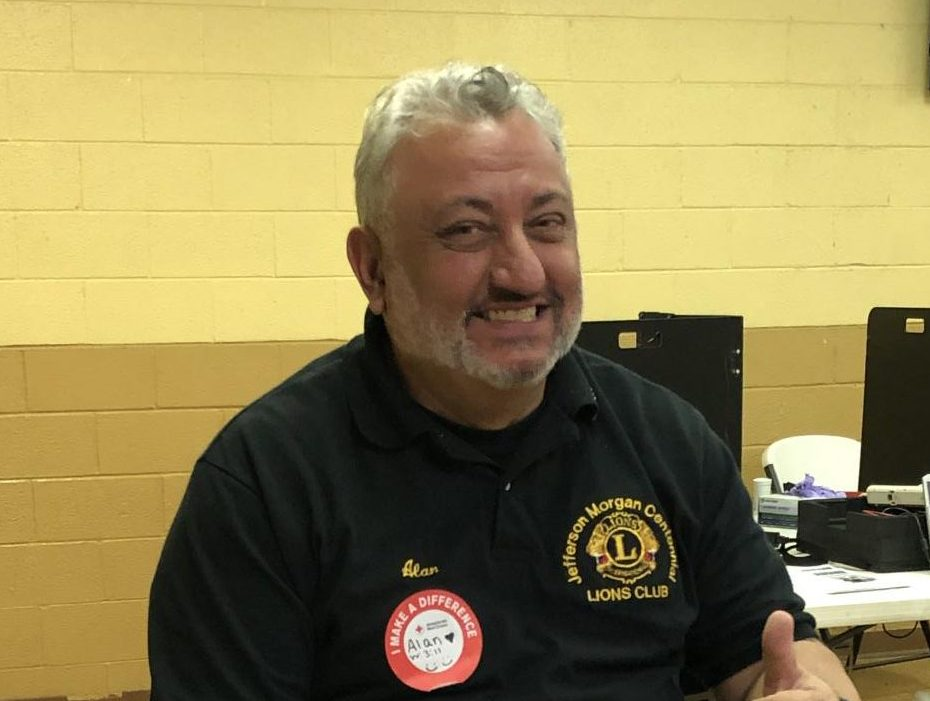 Jefferson-Morgan Centennial Lions Club President and former JM teacher Alan Rafail gave blood at the Red Cross Blood Drive.